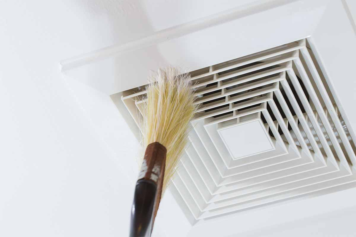 ir duct being lightly brushed with a paint brush