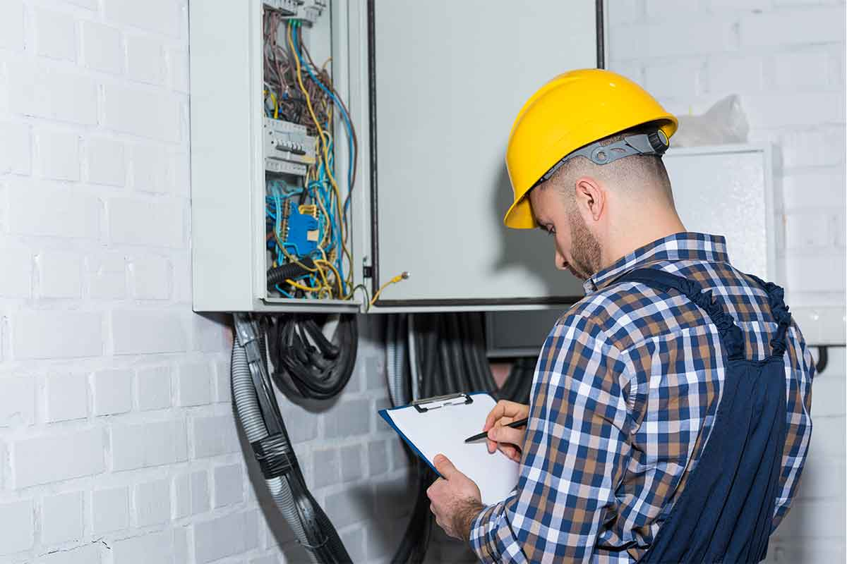 Electrician inspecting an electrical panel