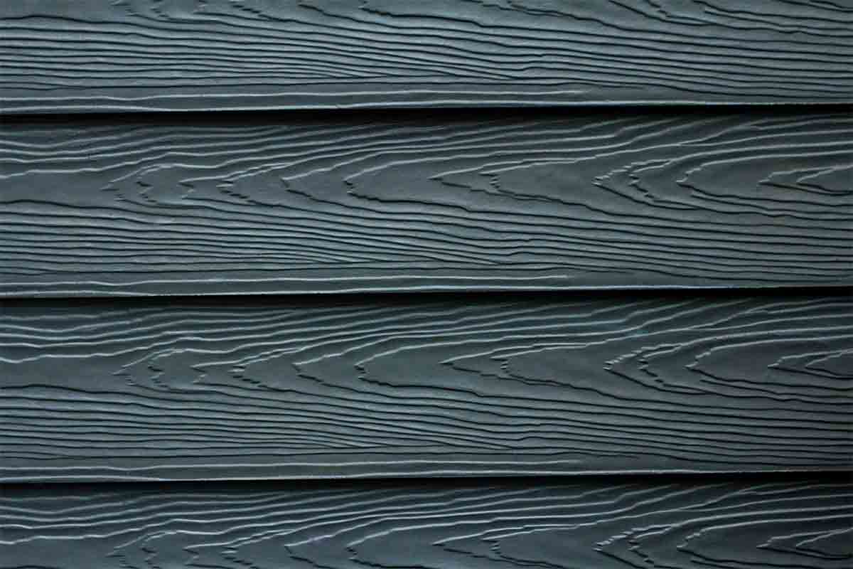 close-up of dark blue fiber cement siding