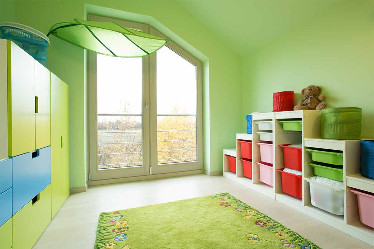 Child's bedroom with light-green walls