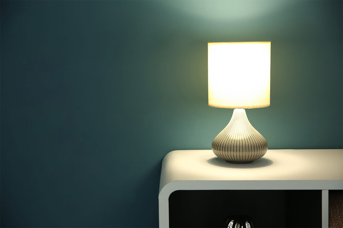 modern-table-lamp-on-a-white-table-with-teal-wall