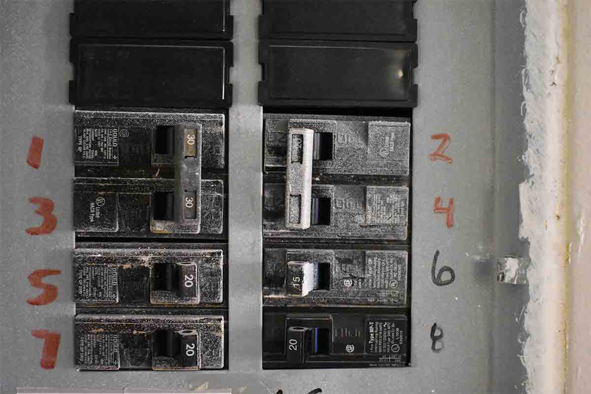 Close-up image of numbered breakers in an electrical panel box