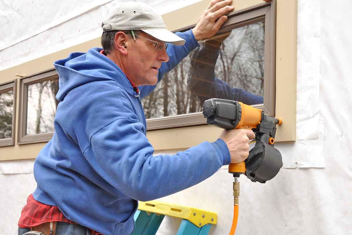 carpenter installing window