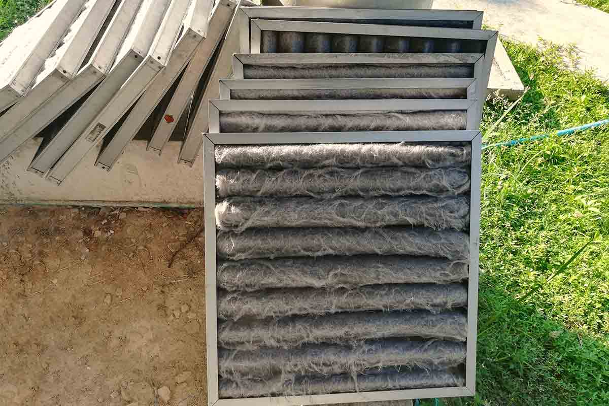 stack of dirty air conditioning filters