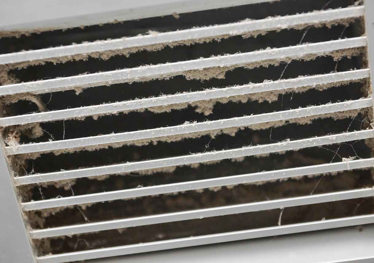close-up image of dirty air vent