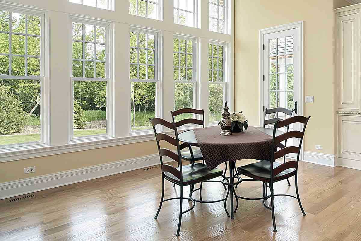 furnished breakfast room with windows