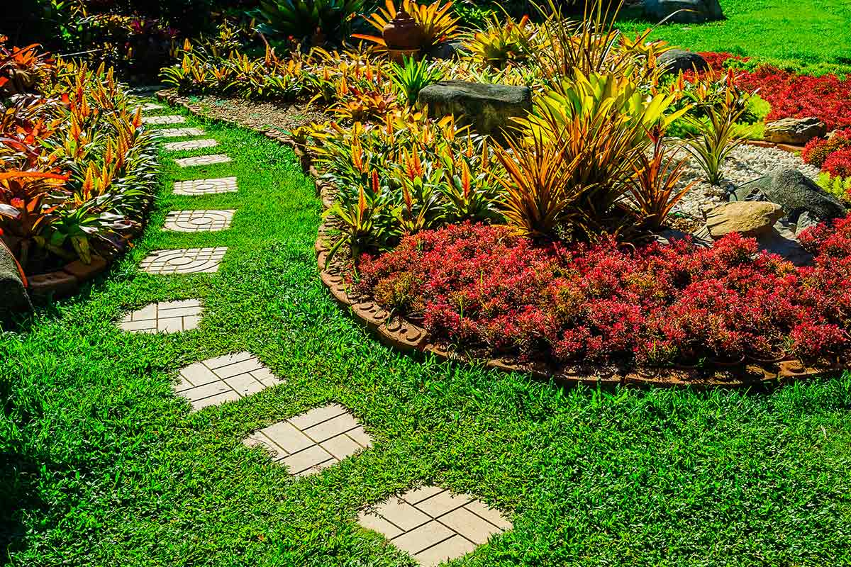 landscaped yard with stepping stone pathways