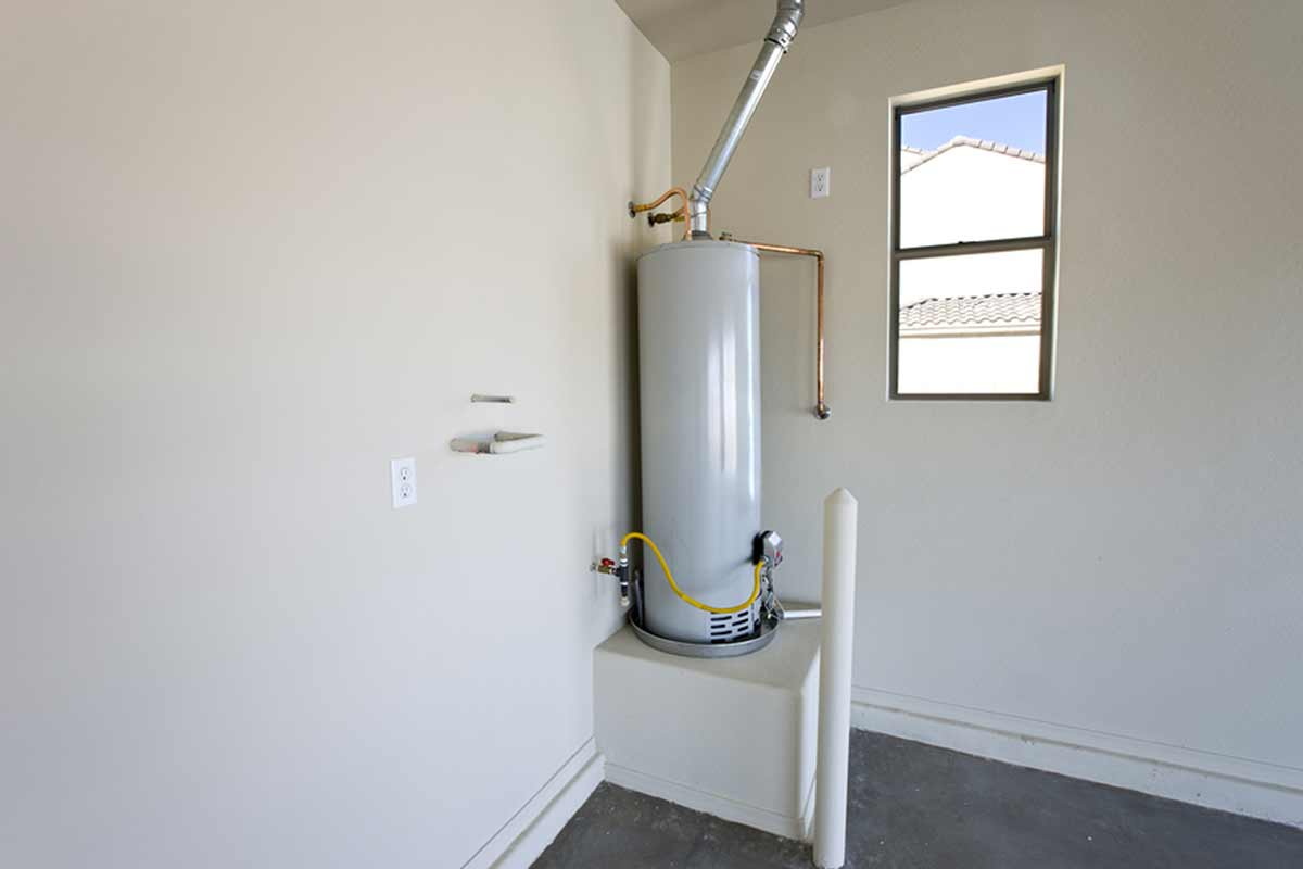 Water heater installed in a corner of an empty room