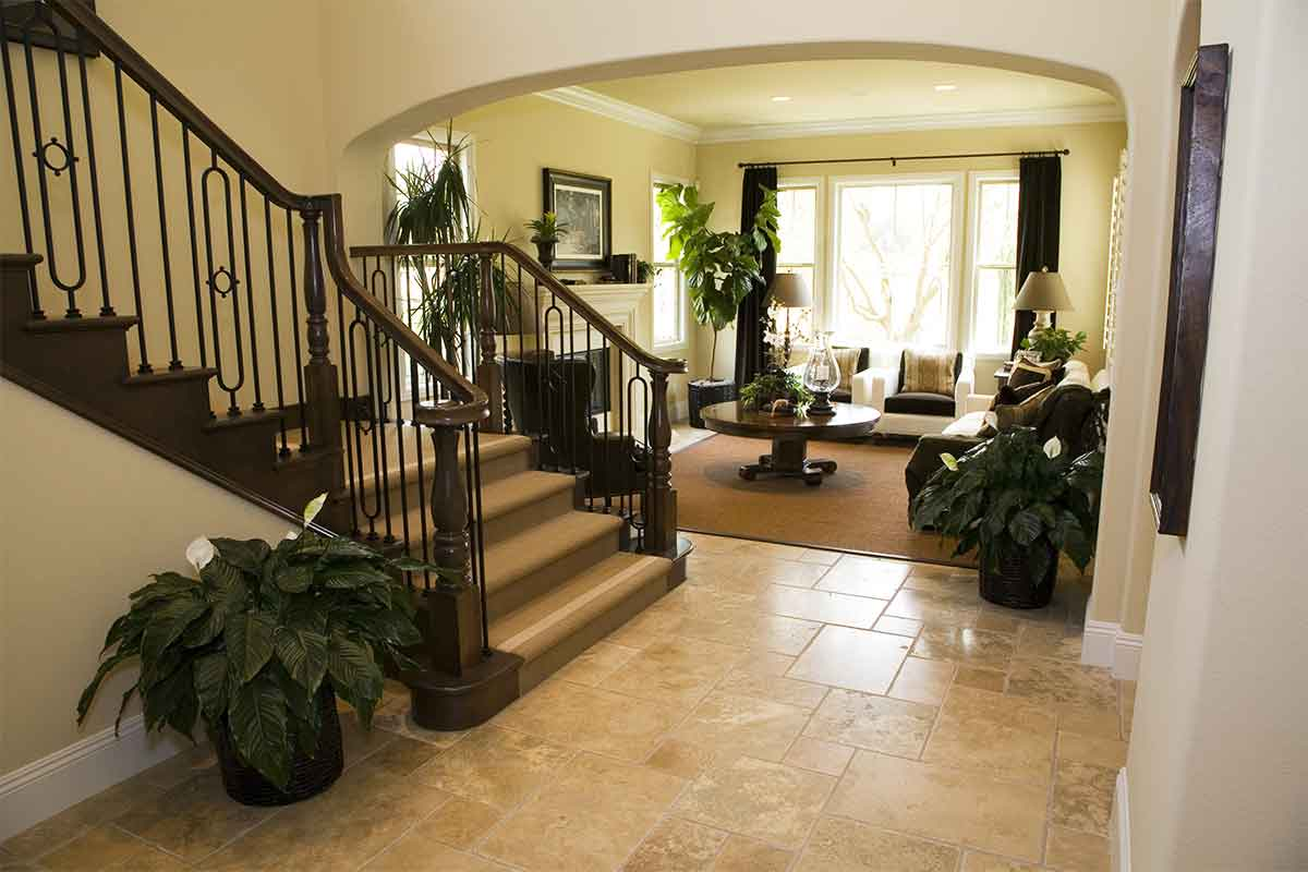 home entryway with beige ceramic tile floor