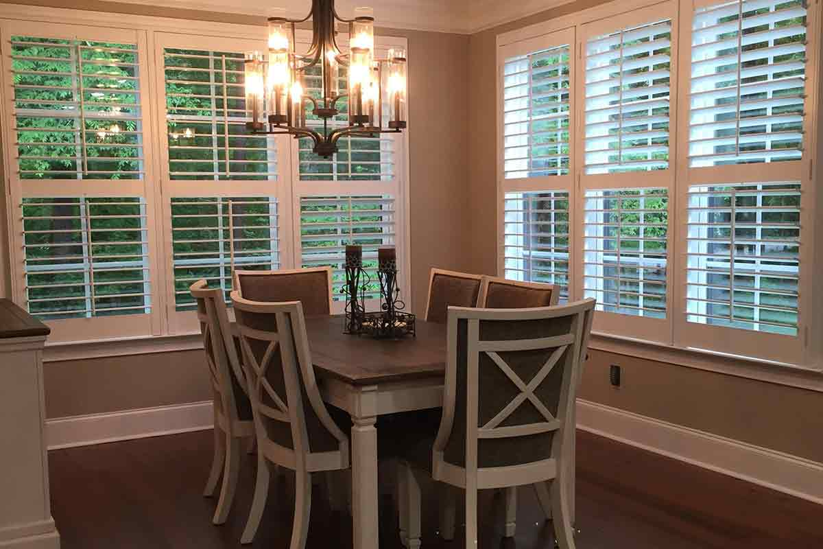 windowed dining area with white plantation shutters