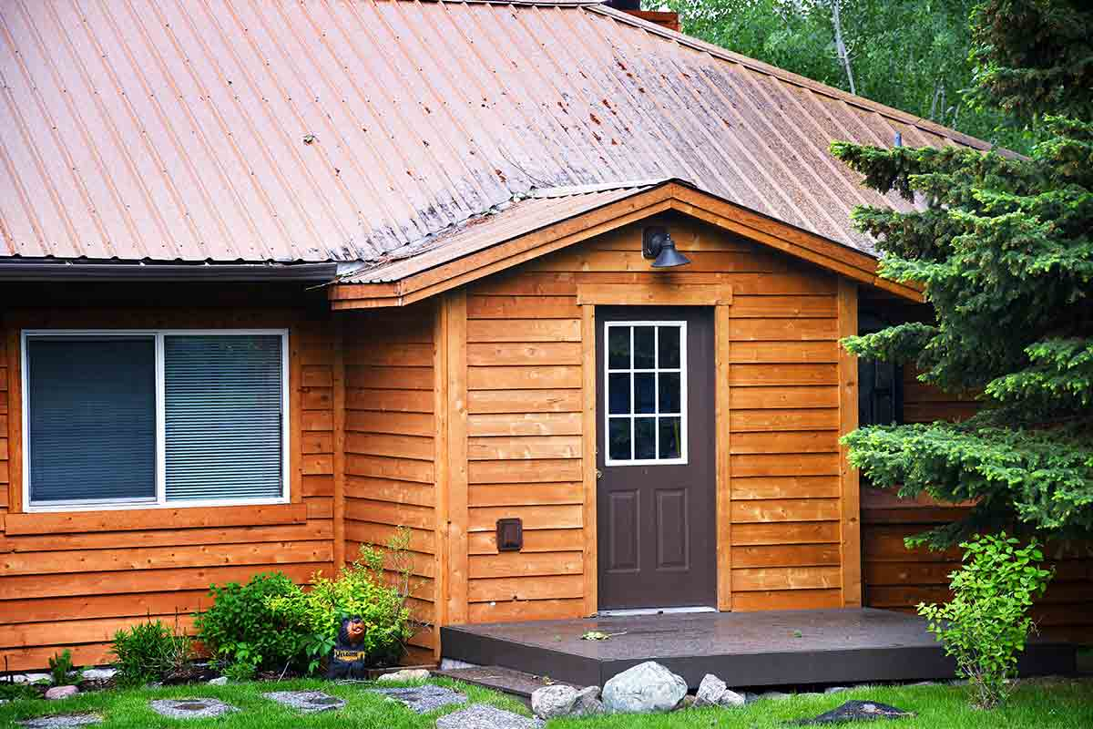 cabin with natural wood siding