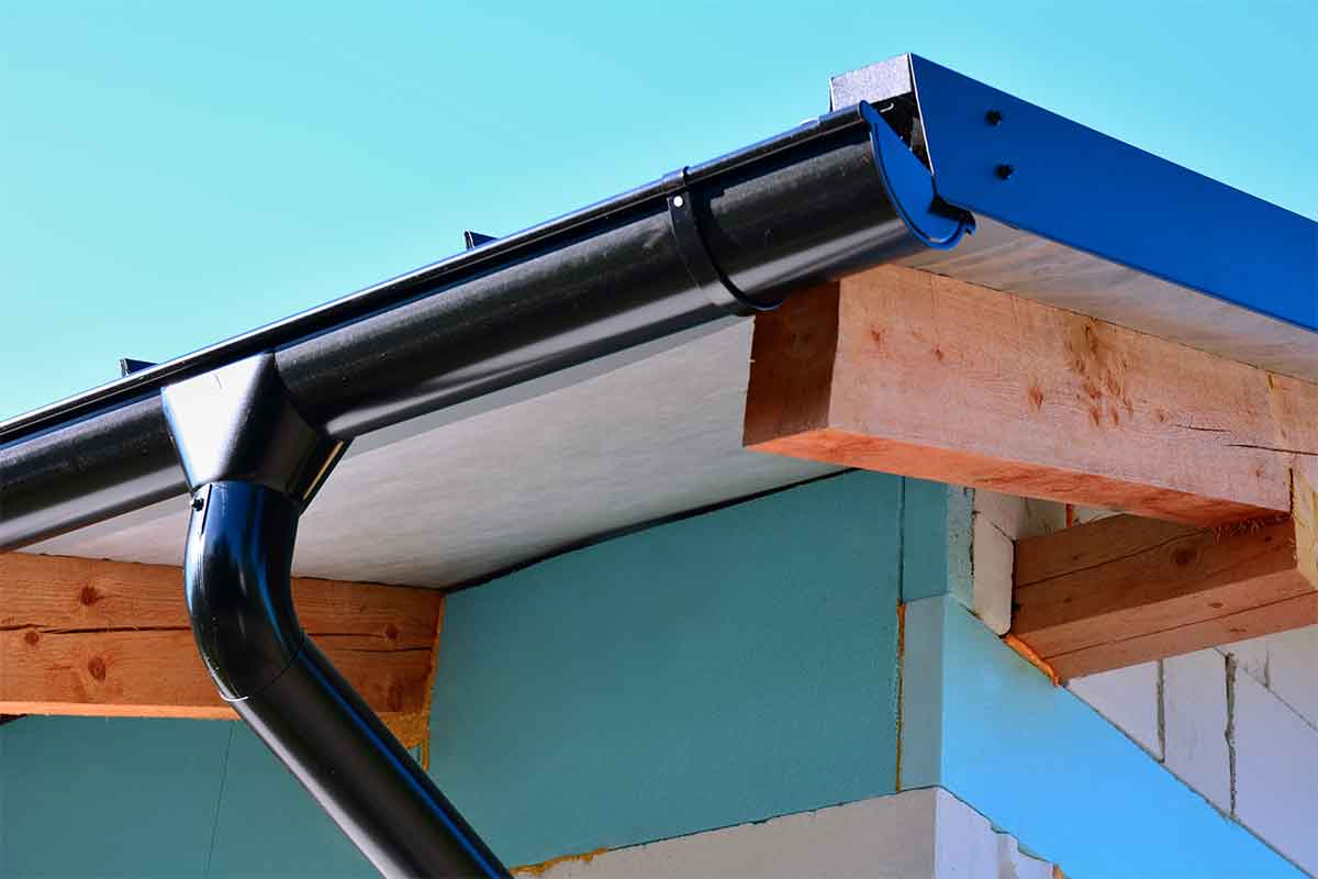 black steel half-round gutters on corner of house
