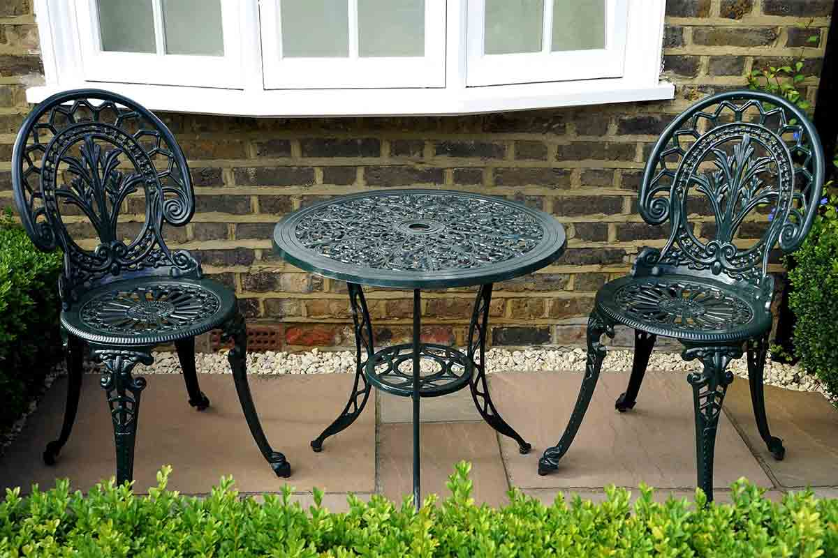 black wrought-iron table and chairs