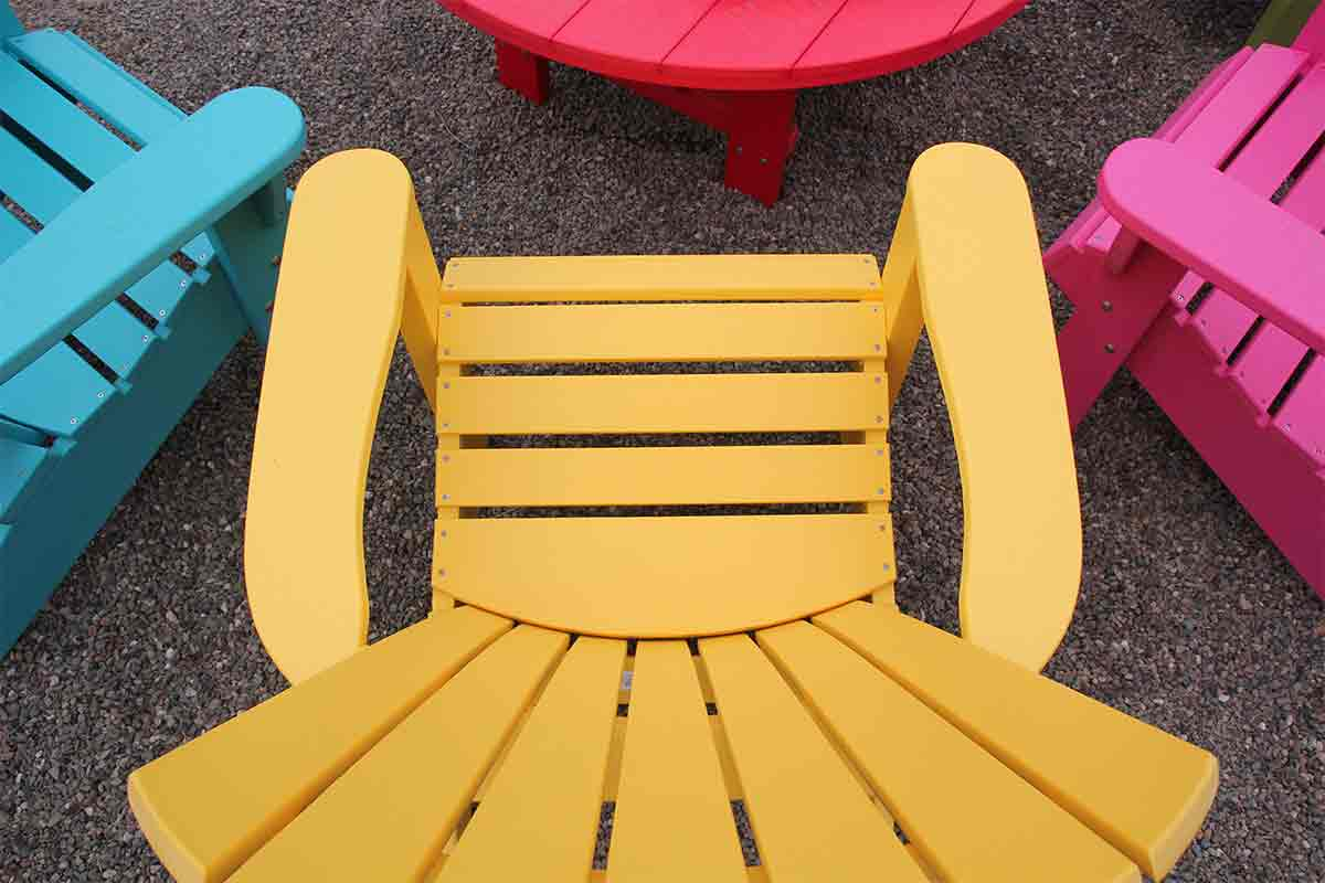colorful plastic patio chairs and table