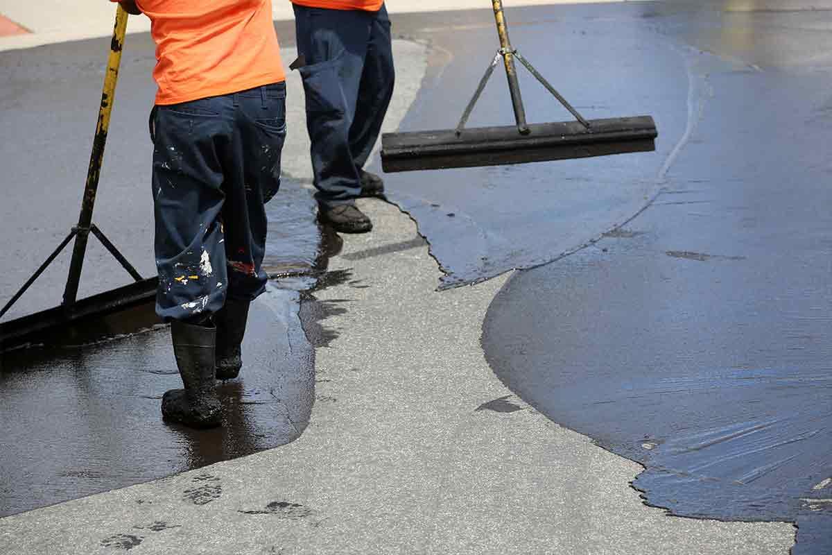 contractors sealing driveway