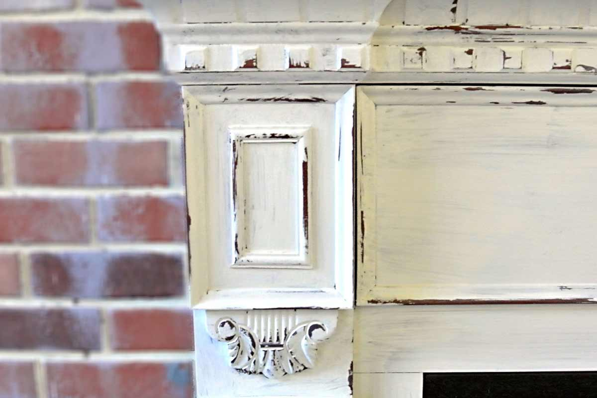 close-up of distressed white fireplace mantle