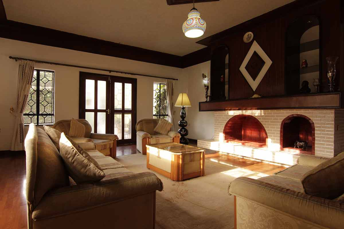 vintage living room with brick fireplace