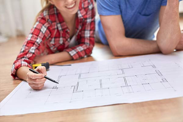 couple looking at a blueprint of a home