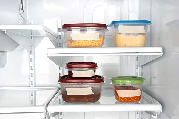 leftovers in fridge with labels