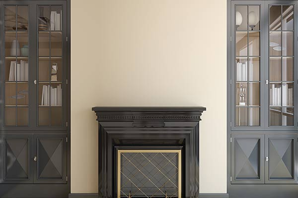black fireplace against a cream wall