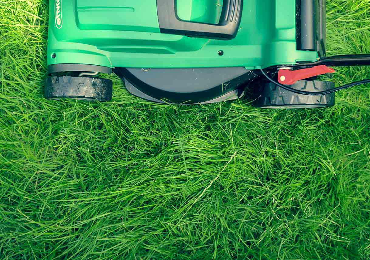 Aerial view of lawn mower on grass