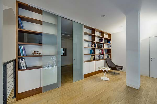 spacious living room with bookcases