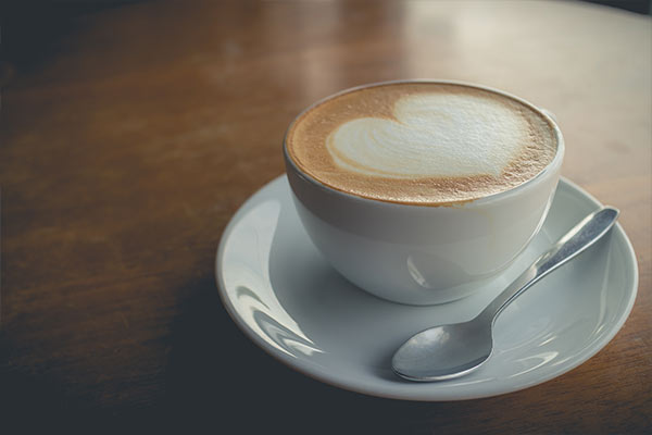 Cup of coffee with heart in foam