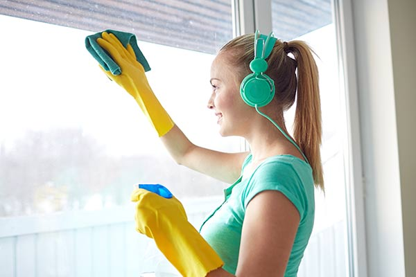 girl with headphones cleaning