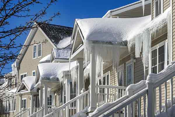 ice dams hanging on roofs and gutters of houses
