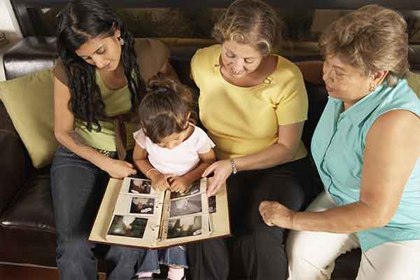 family looks at photo album
