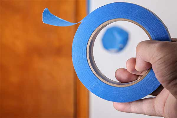 Blue tape is the best kind for sticking to walls and creating designs