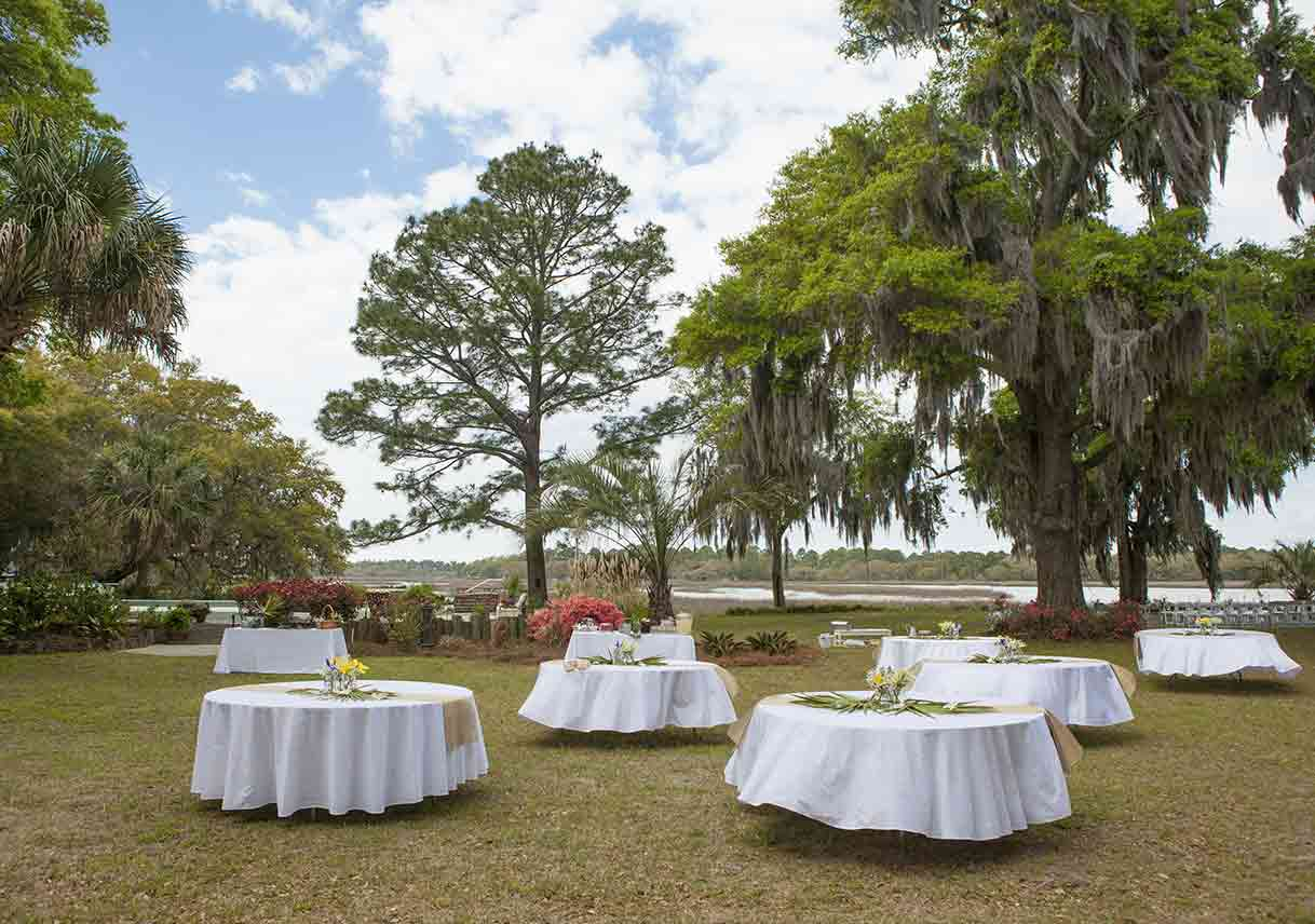 tables set up for wedding reception outside at country club