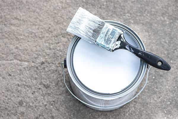 can of white primer on concrete floor