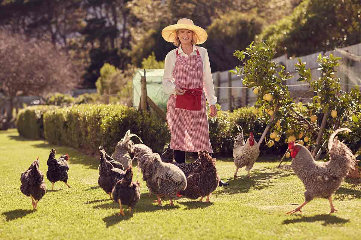 woman with chickens on urban farm