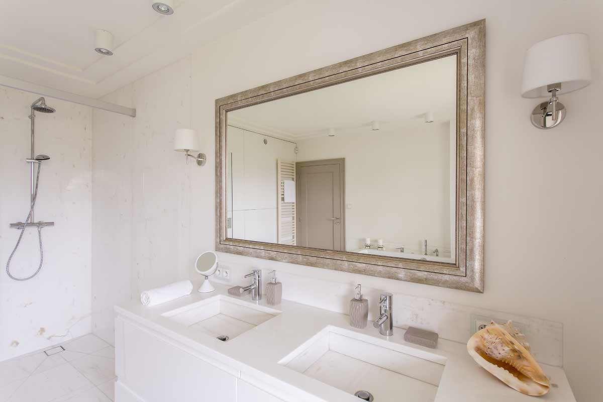 Master bathroom remodel with large, framed mirror