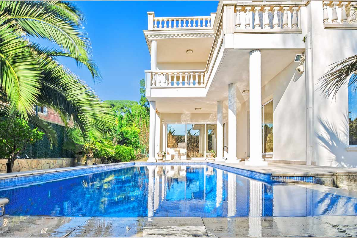 white mansion with swimming pool