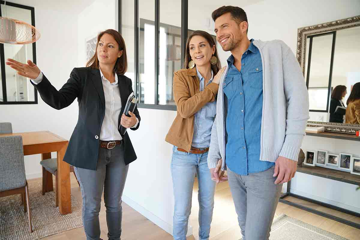 Seller with couple at open house event