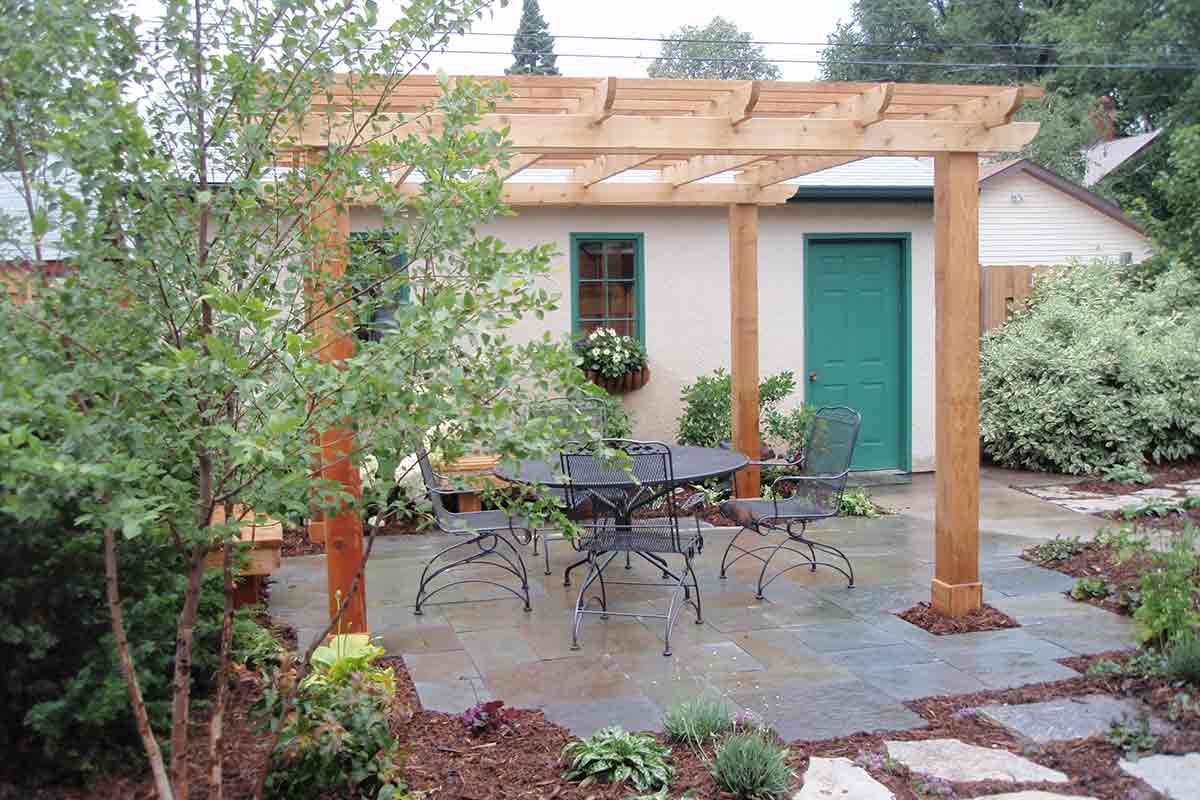 Natural wood pergola on a stone patio