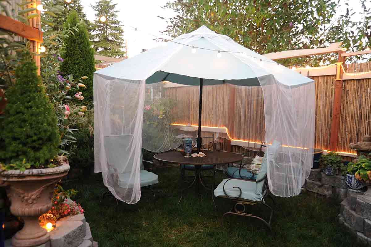 White netting draped over a patio umbrella