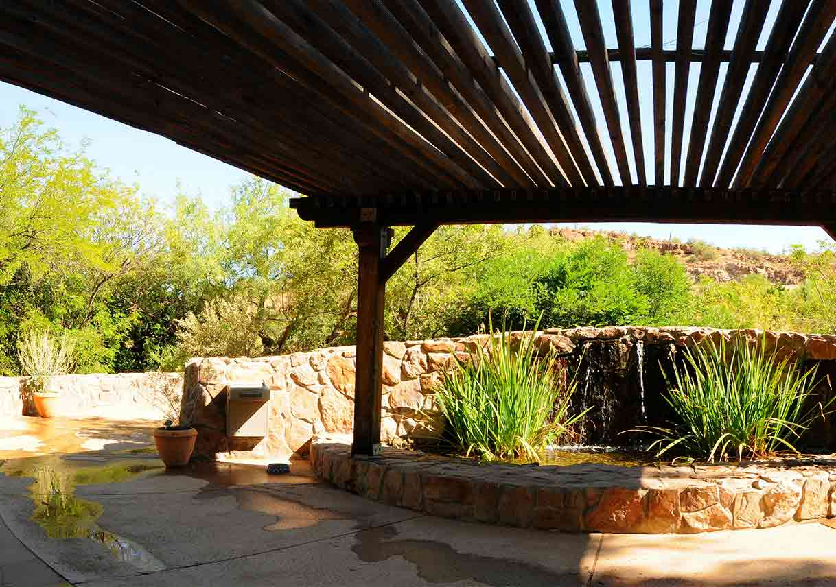 Southwestern-style patio with fountain and plants