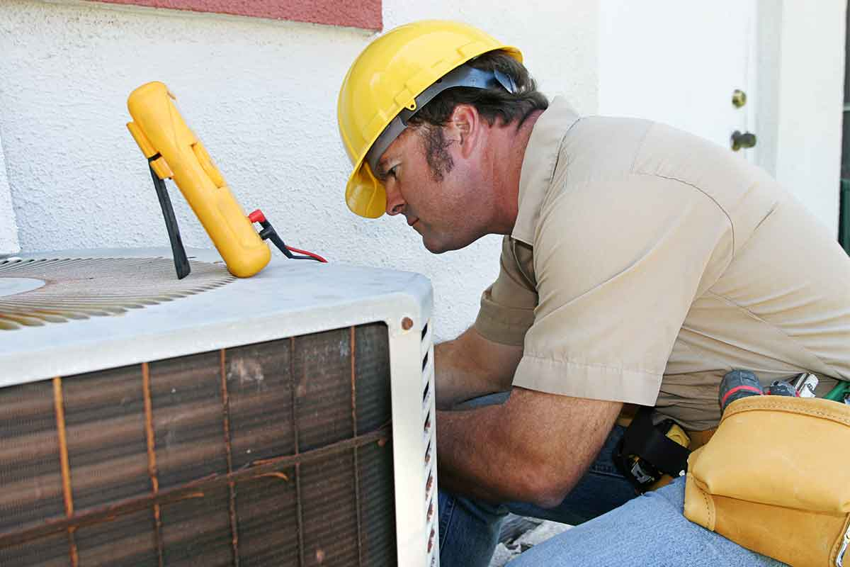 hvac professional fixing an air conditioner