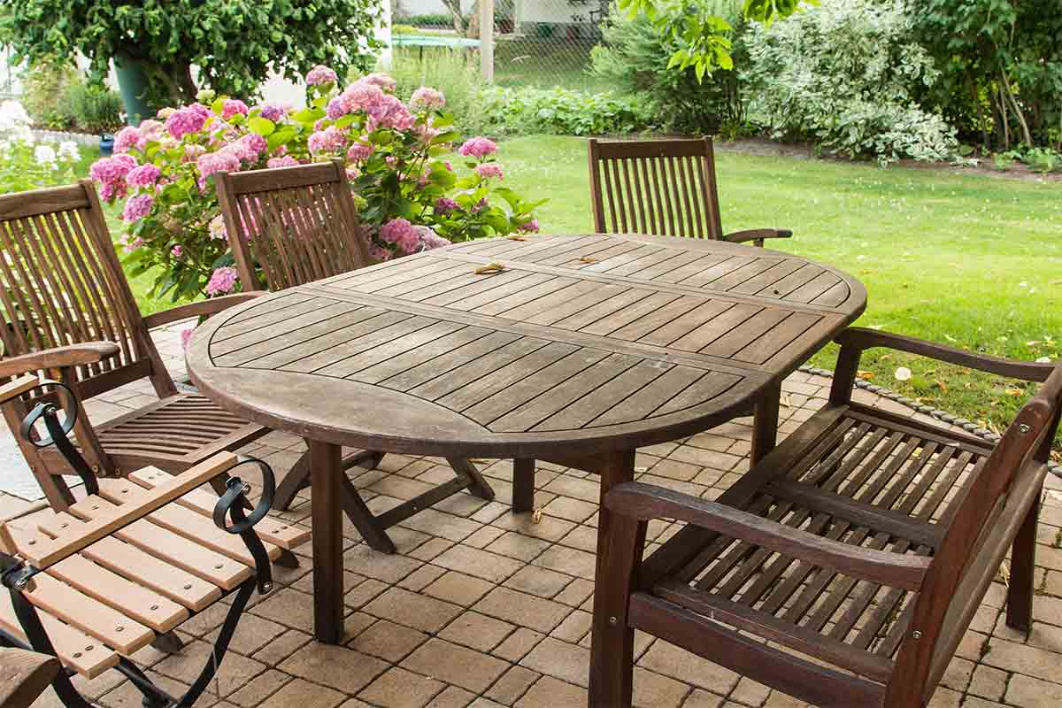 Set of teak patio table and chairs