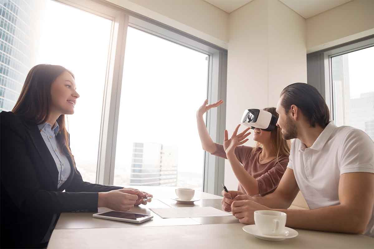 woman wearing virtual reality goggles with real estate agent