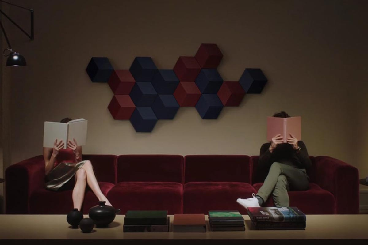 Couple reading in front of a hexagonal sound system