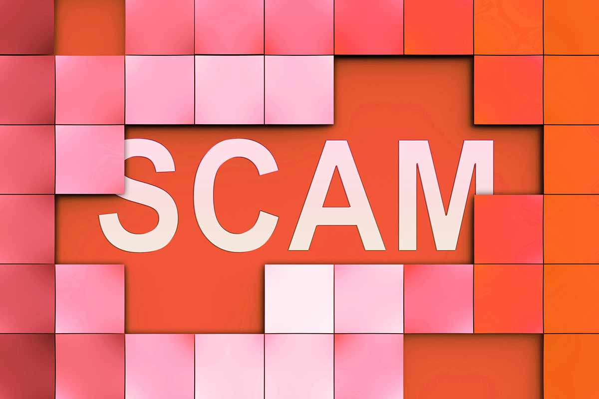 Red and white picture of the word scam