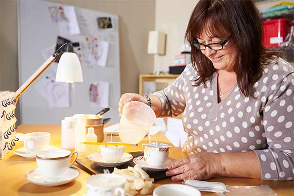 mature woman making candles at home
