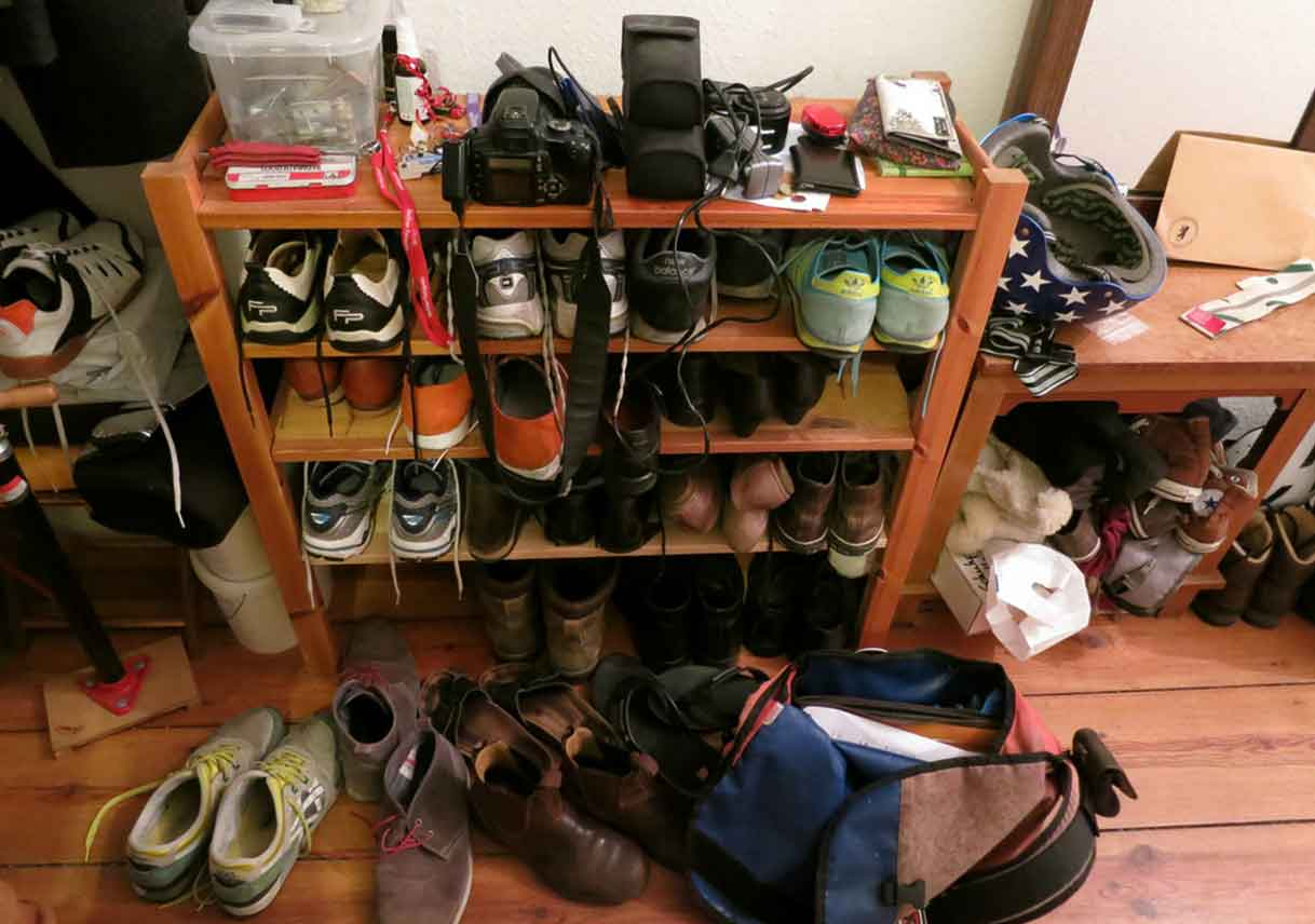 full shoe rack on wooden floor