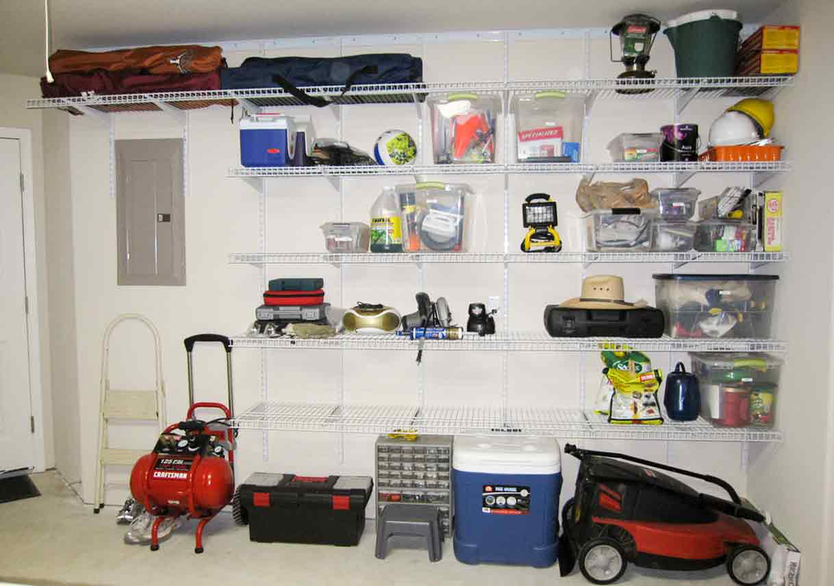storage space with wire wall and ceiling shelves