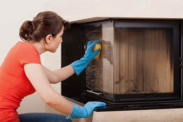 woman cleaning fireplace