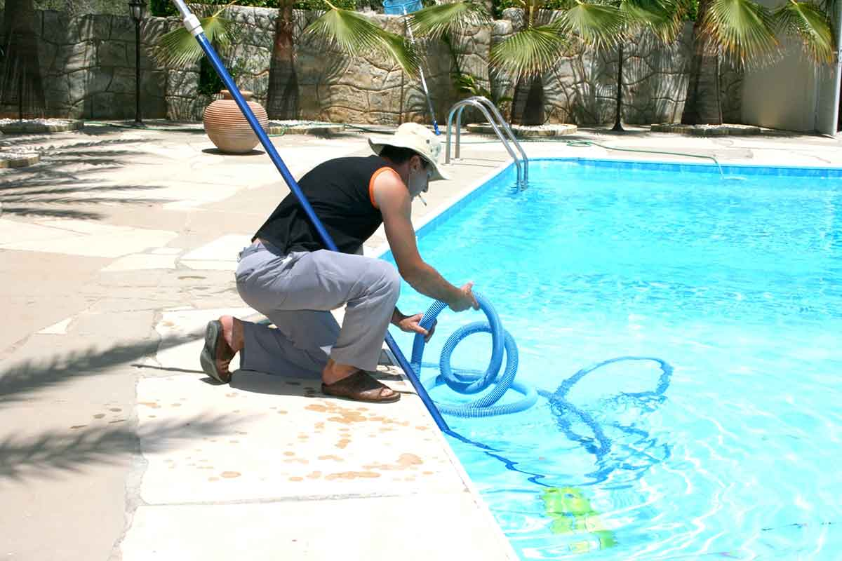 man cleaning a pool